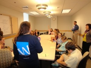 Students in a breakout session during our annual conference discuss tutoring strategies.